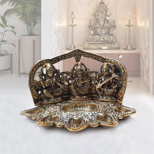 Fabulous Metallic Diya with Ganesh, Lakshmi N Saraswati Idol