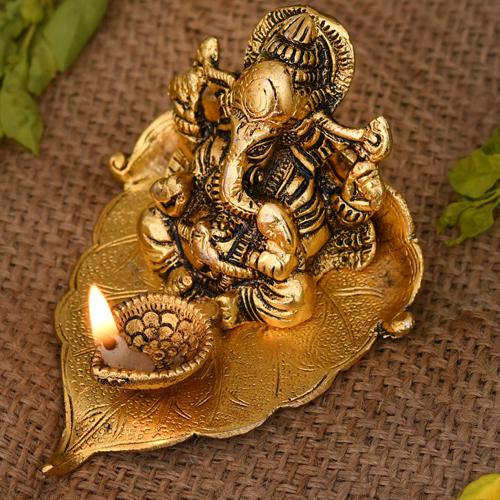 Exclusive Ganesha on Leaf with Diya