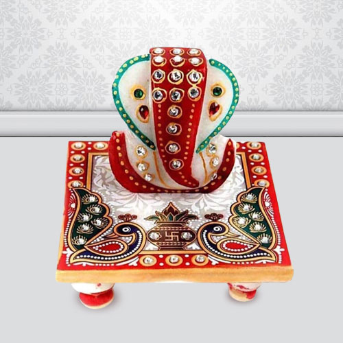Propitious Marble Ganesh Chowki with Peacock Design