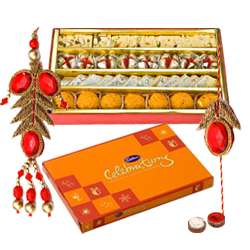 Lovely Gift of Well Prepared Haldirams Sweets and a Pack of Divine Cadbury Celebration